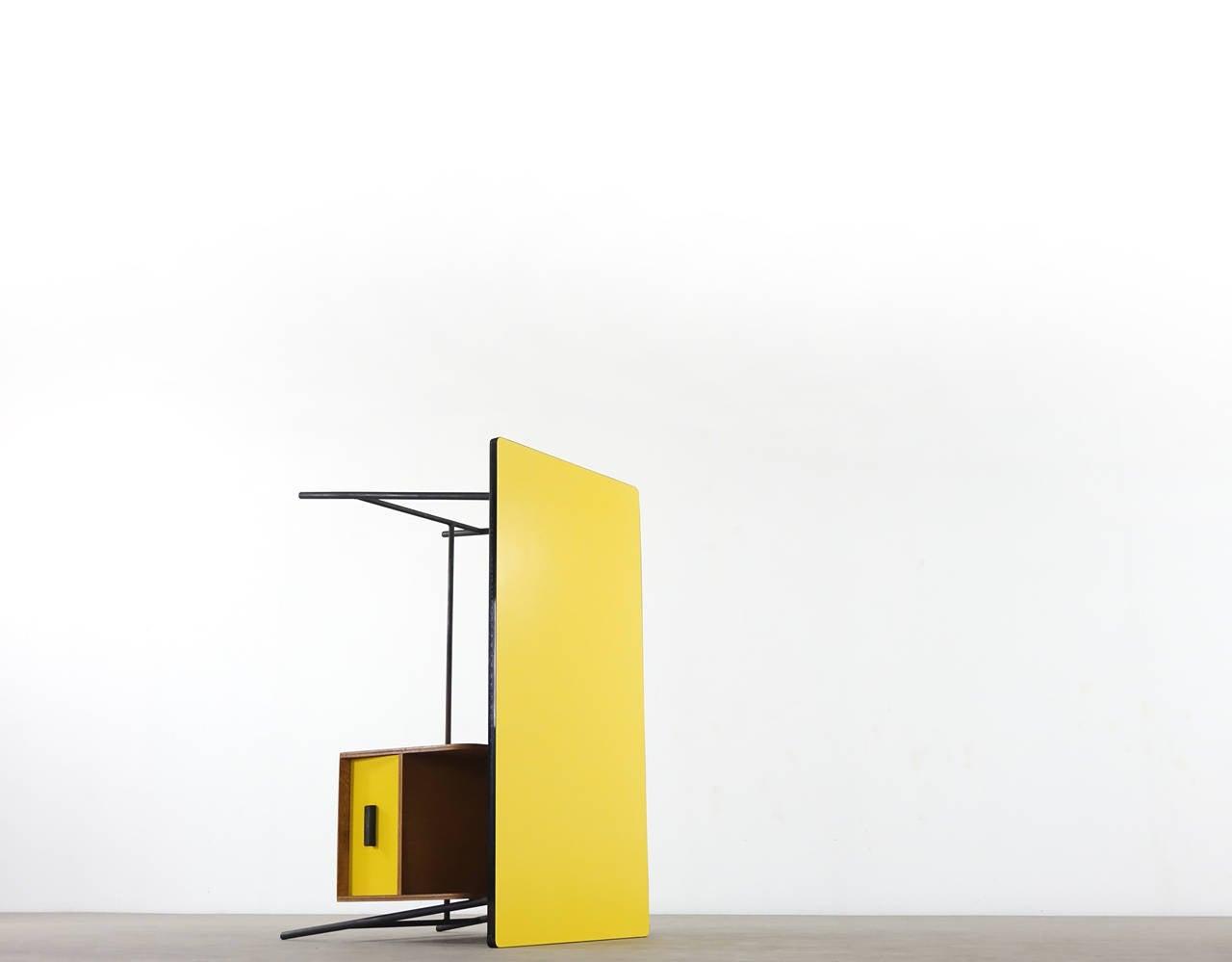 wonderful desk in bright & warm yellow formica by Pierre Paulin.. black metalframe, wooden shelf with drawer