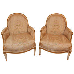 Pair of Louis XVI Style Cream Painted Parcel-Gilt Bergère