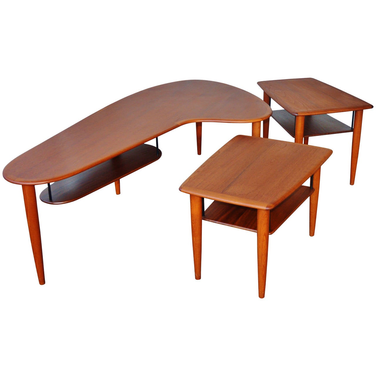 teak boomerang coffee table and matching pair of side