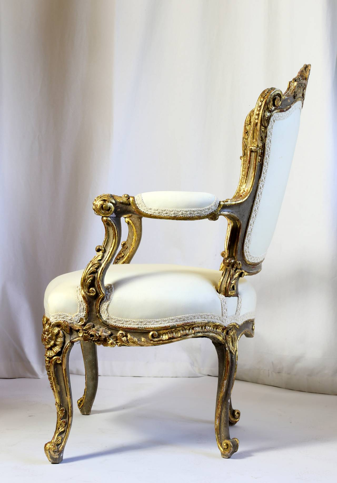 Italian Heavily Carved and Gilded Rococo Open Armchair For Sale at