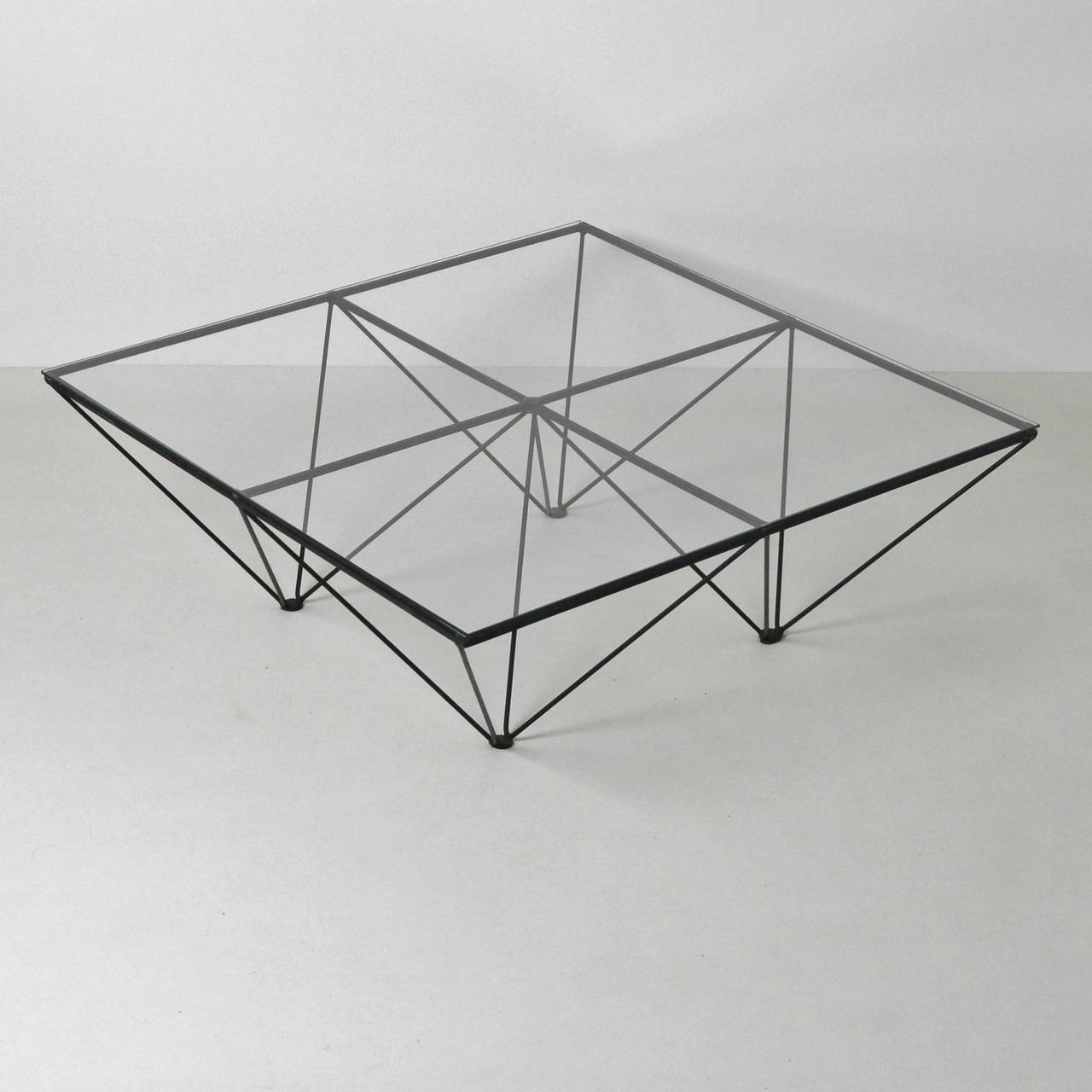 A Wire Framed And Glass Topped Coffee Table In The Manner Of Paolo Piva S Iconic