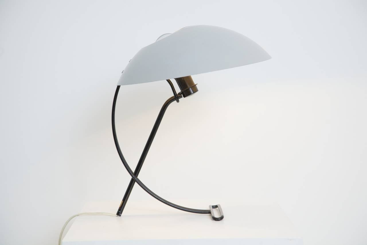 Louis kalff for philips nb100 desk lamp at 1stdibs the nb100 features a black enameled thick gauge wire structure with a light grey enameled greentooth Gallery