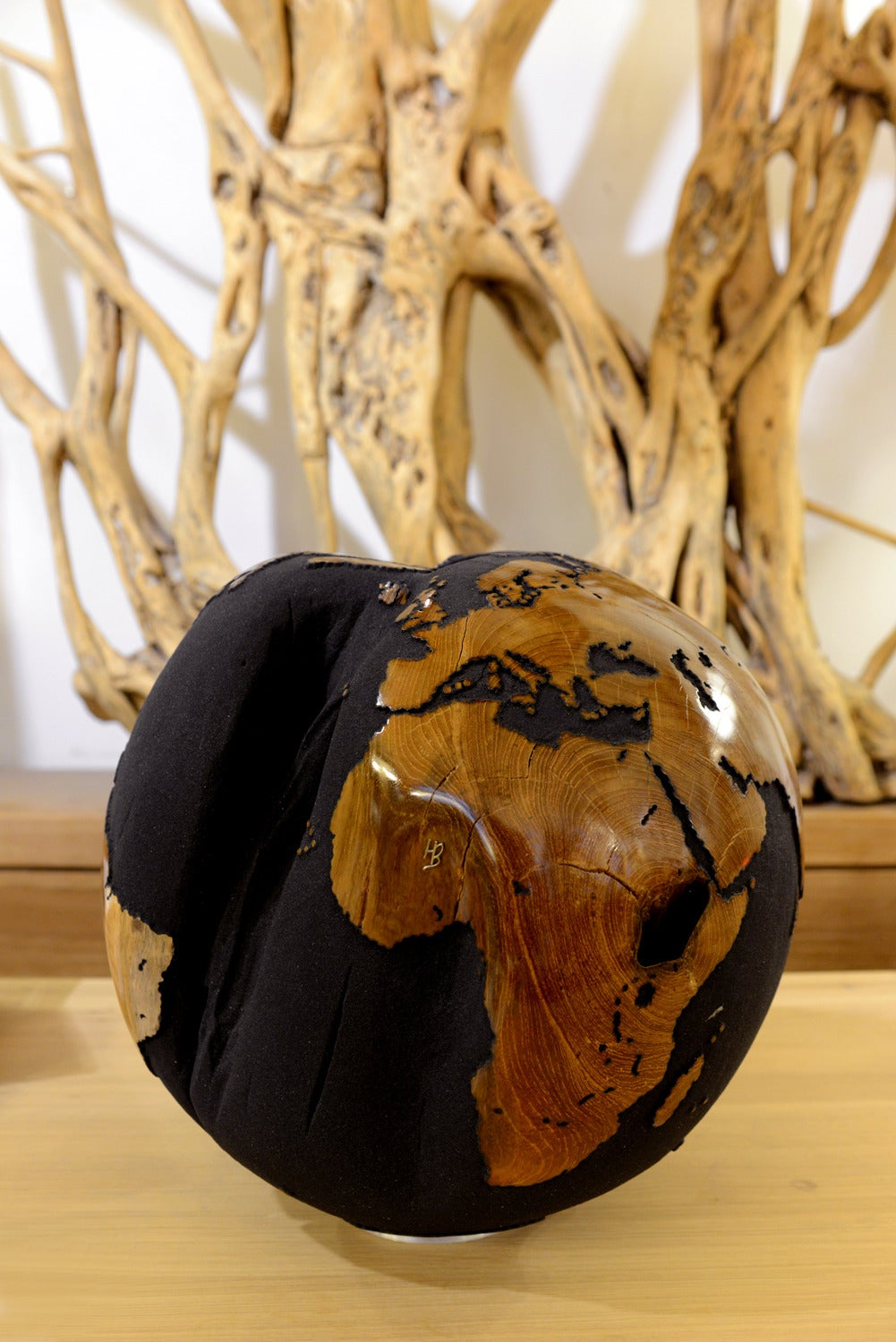Contemporary Globe in Teak Root with Black Sand of Volcanic Rock For Sale