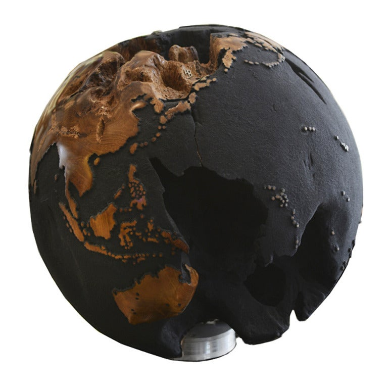 Globe made of teak root and composed  of black volcanic rock sand. Exceptional piece. Pacific Compagnie collection.