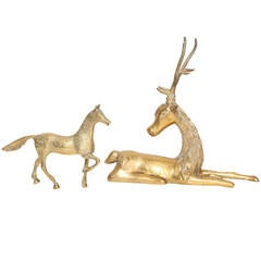 Hollywood Regency Gilt Brass Recumbent Deer and Prancing Horse