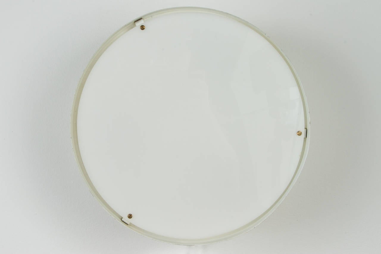 1950s Jacques Biny Ceiling Light for Luminalite. Executed in white enameled aluminum with opaque diffuser for Luminalite, France.  Not UL listed, but available upon request.
