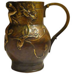 Alexandre Charpentier, an Art Nouveau Patinated Bronze Jug, Signed