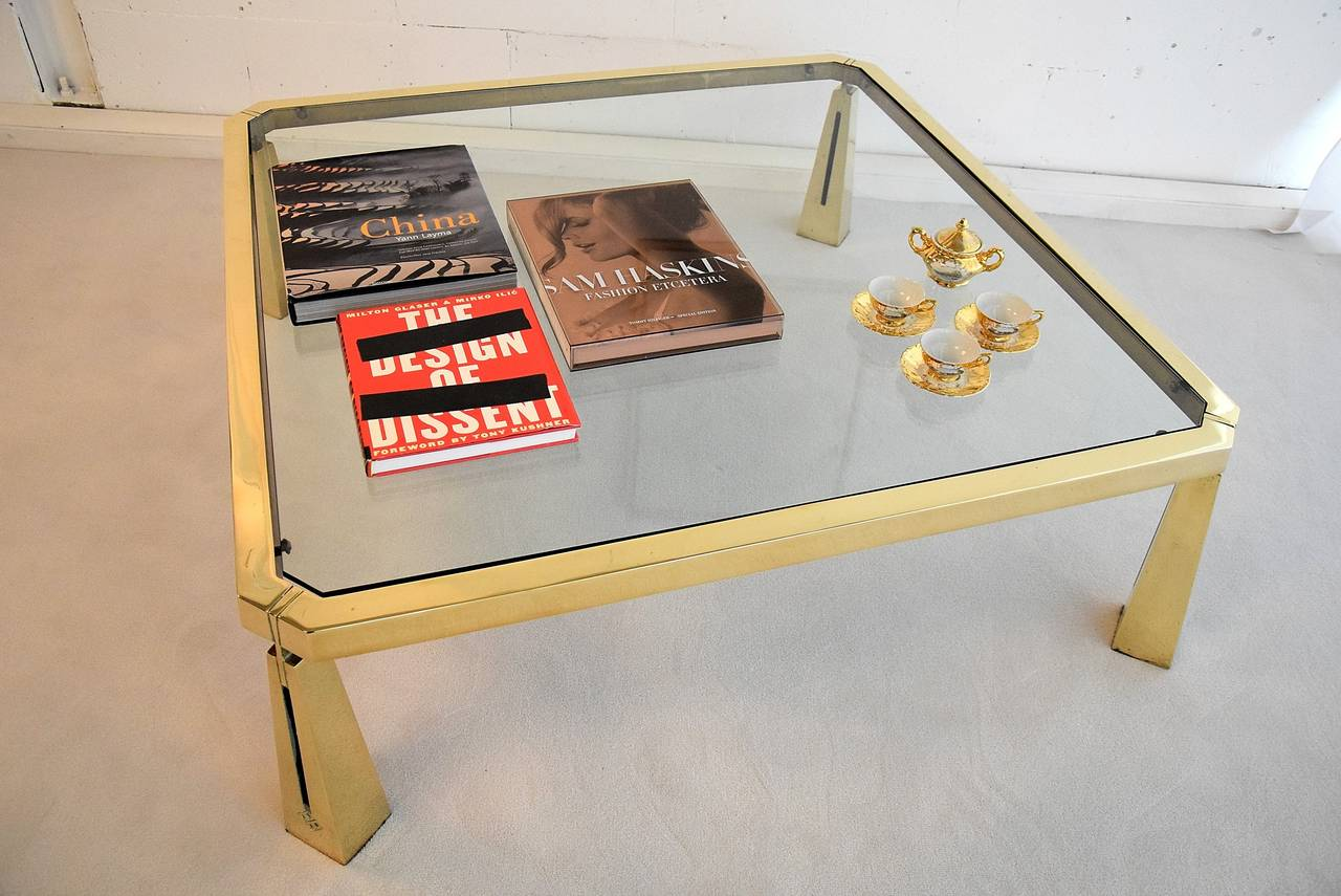 """Coffee table hollywood regency Peter Ghyczy Very rare early 1980's solid brass eclectic coffee table designed and produced by  Peter Ghyczy in very limited quantities for only a couple of years.  The definition of Eclectic: """"made up of what is"""