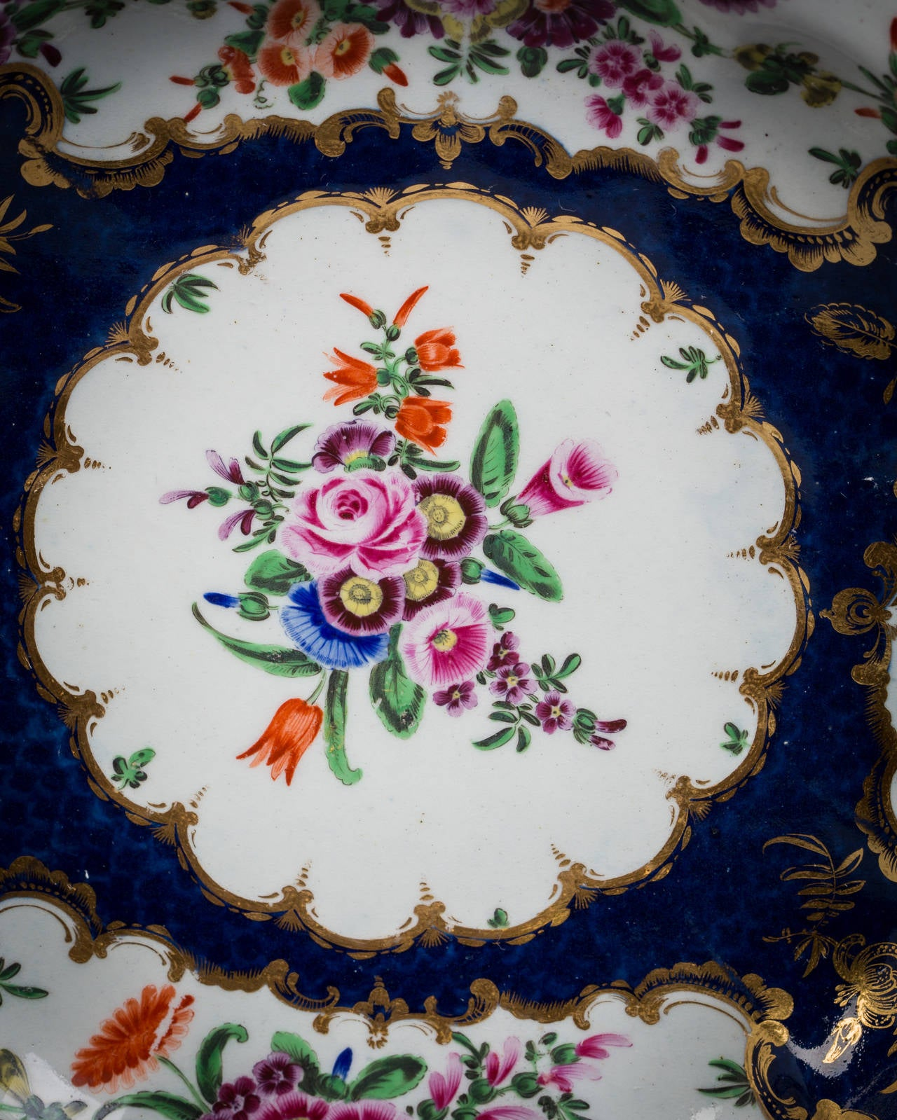Pair of English porcelain, blue-scale scalloped plates, Worcester, circa 1770.