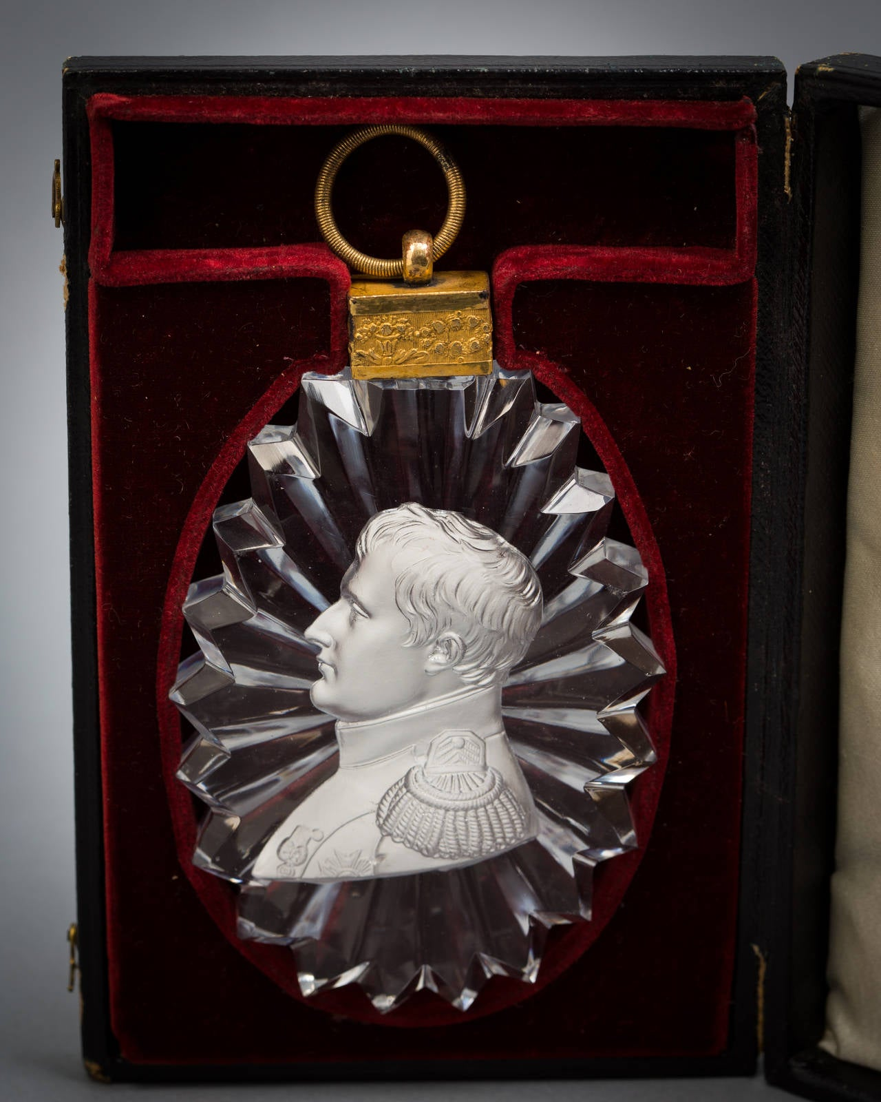 A French sulphide portrait cut-glass pendant plaque of Napoleon in the uniform of Colonel of the Guard, after the medal by Andrieu.