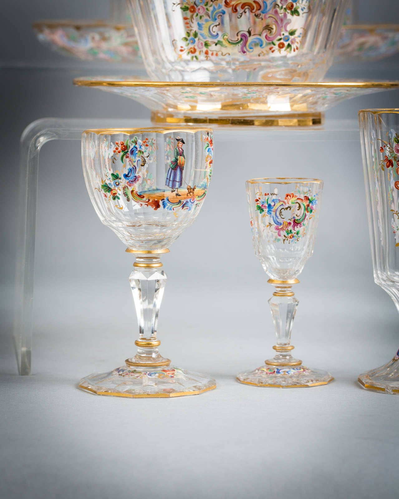 Pair of large water jugs, one smaller jug, pair of vases, decanter and stopper, liquor decanter and stopper, four liquor glasses, twelve water glasses, twelve champagne, eight wine glasses, three finger bowls and stands, tazza, set four