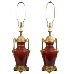 Pair of Gilt Bronze Mounted Sang De Boeuf Lamps, circa 1860