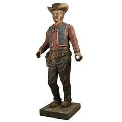 Antique Hand-Carved Wooden Cowboy Sculpture