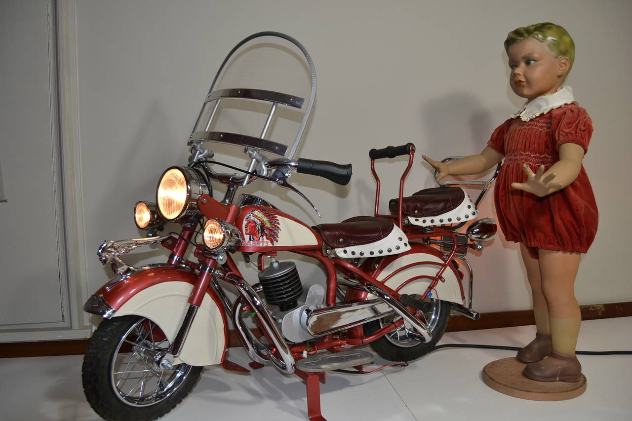 Carousel Indian Motorbike or  Indian Motorcycle by Jeff Lenaerts, Belgium.  This child's motorbike was used on the roundabout and is very realistic to the real Indian motorbike. This Metal Carnival Ride Motorbike has leather sadles , original
