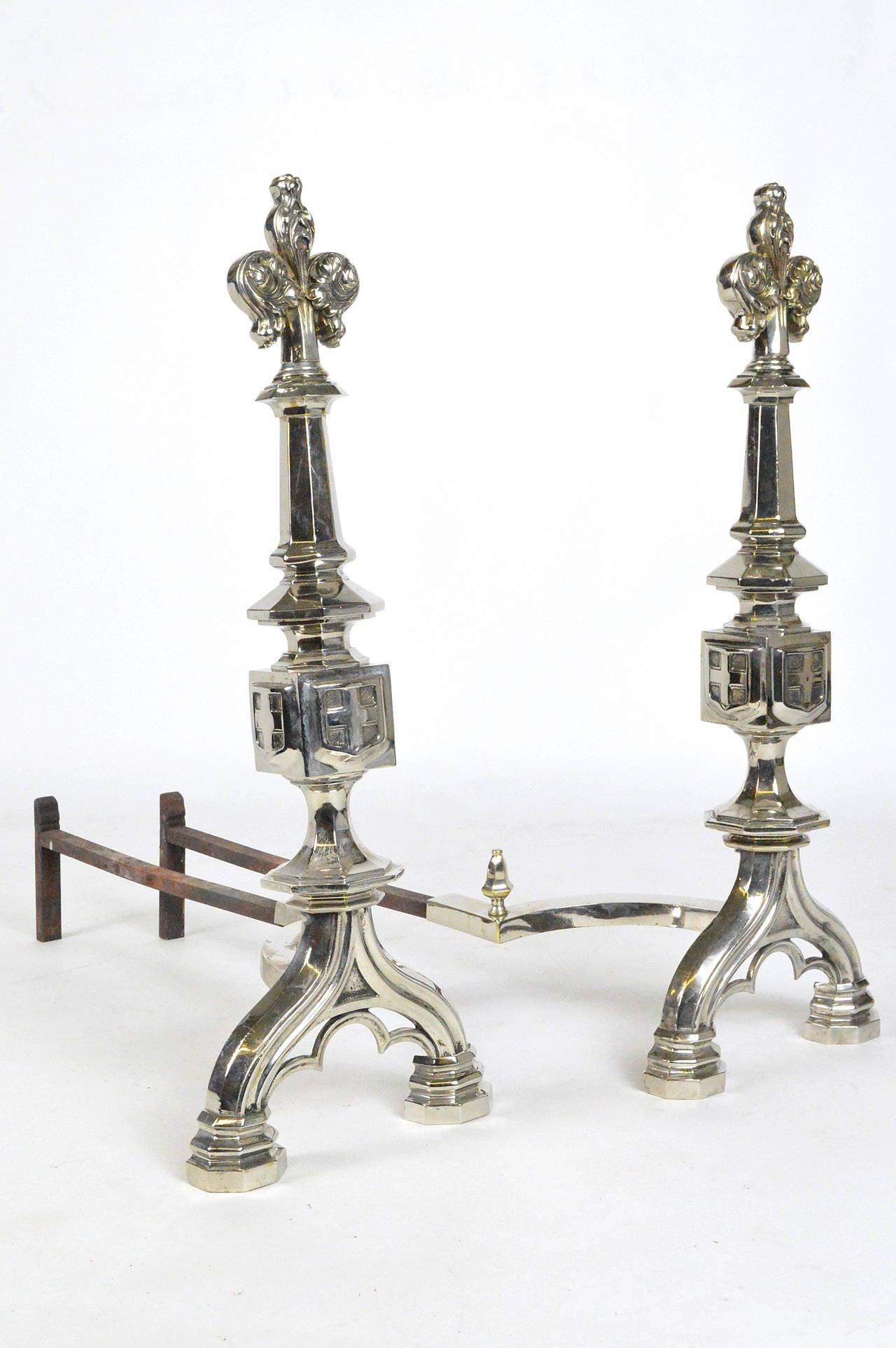 Pair of Fleur De Lis motif silvered bronze andirons, circa 1910.