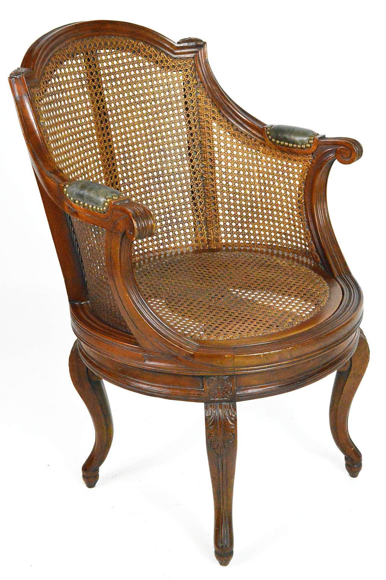 French Louis XV Style Cane And Walnut Swivel Barrel Back Armchair For Sale