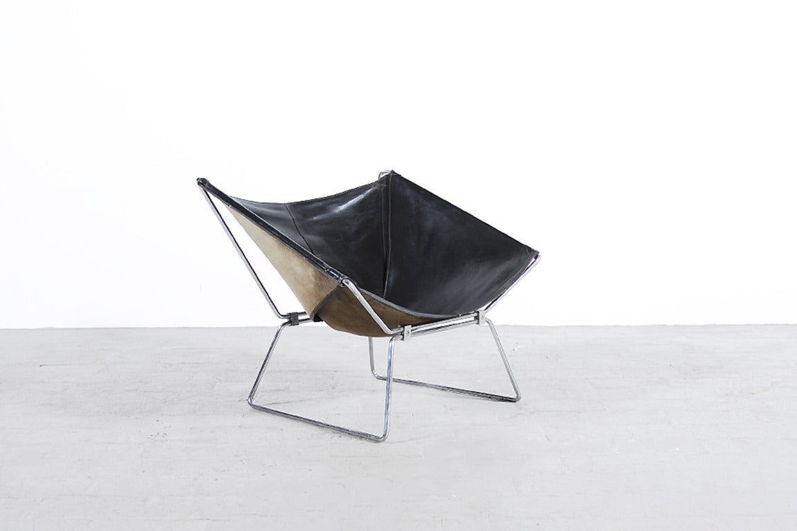 """Armchair AP-14 named also the """"Anneau Chair"""" designed by the french designer Pierre PAULIN. First Edition by AP Originals, 1954. Black Leather and Chrome Steel frame. The second version of the Anneau Chair was edited by """"Meubles"""