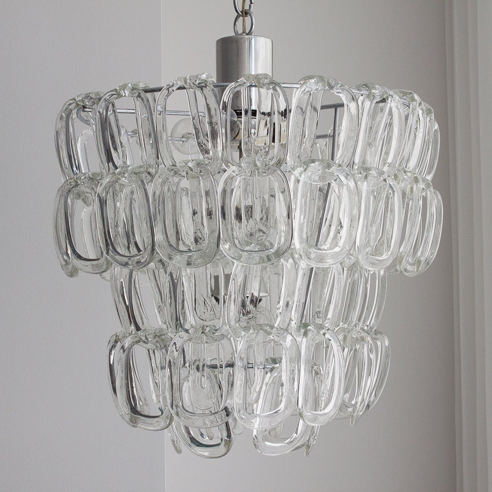 This Mangiarotti Chandelier Features A Chrome Plated Frame And Three Tiers Of 72 Handblown Glass Chain