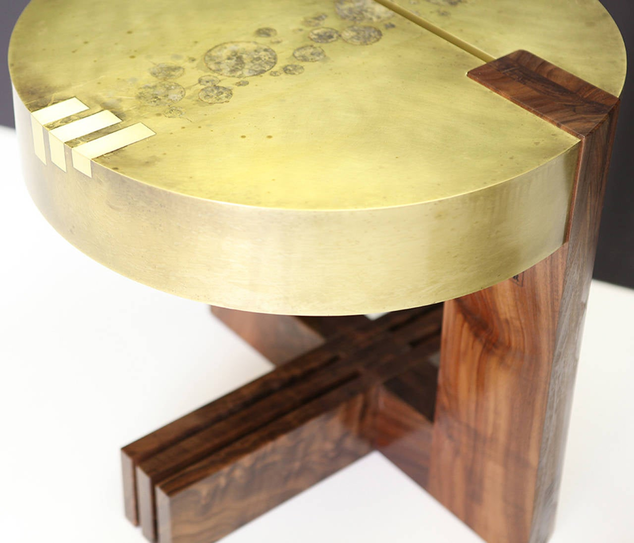 "In our ""3-2-1"" original table, the magic happens in the intricately designed etch pattern on the brass top. A prime example of Studio Roeper's signature style of mixing wood and metal elements into a harmonious blend. Protected with"