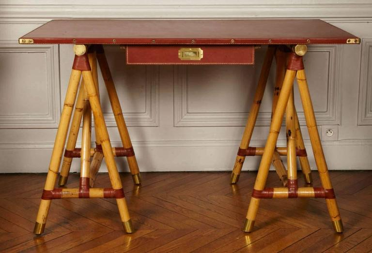 Rare Campaign desk with real bamboo feet and cognac stitched leather.