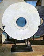 White Stone Coin or Wheel on Stand