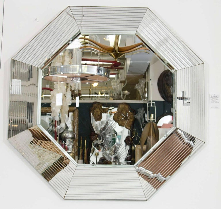 This is an incredible vintage '70s Modern or Post-Modern [Postmodern] period octagonal wall mirror in the style of designer Karl Springer. This is a very beautiful and large mirror; a special mirror, a statement piece. Mirror's detailed 'mirrored