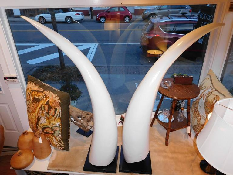 A towering and believable pair of hand-carved wooden elephant tusks by Franz Reich. There is no ivory content in these tusks (wood).