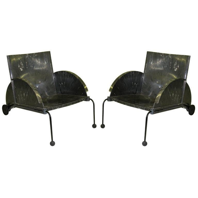 Comfortable, chic pair of Italian Mid-Century Modern lounge /club chairs / armchairs by Castelli Ferrieri for Kartell featuring both innovative design and a mix of recycled poly materials. The all weather materials allow the chairs to be used in and