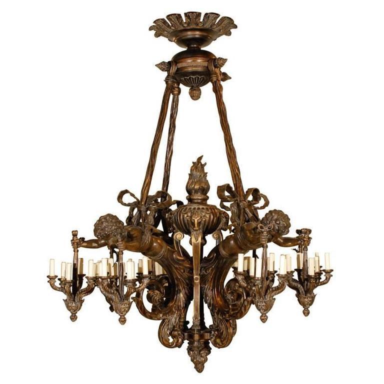 Antique Chandelier. Wood and bronze chandelier with cherubs - Cherub Chandelier For Sale At 1stdibs