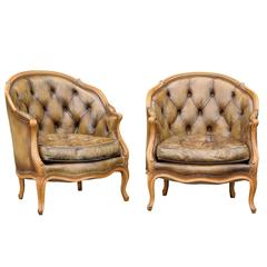Pair of 1940s French Louis XV Style Tufted Leather Barrel Back Bergeres Chairs