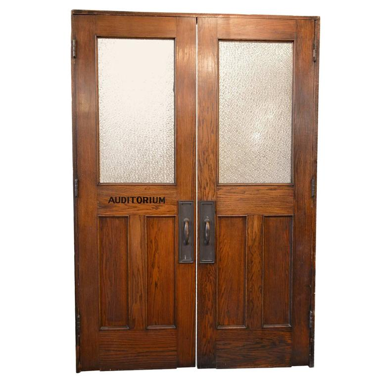 Vintage Auditorium Doors In Oak With Textured Glass And Original Hardware  For Sale