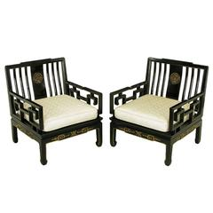 Pair of Ebonized and Parcel-Gilt Asian Club Chairs