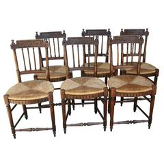Set of Six 19th Century French Directoire Style Carved Walnut Rush Seat Chairs