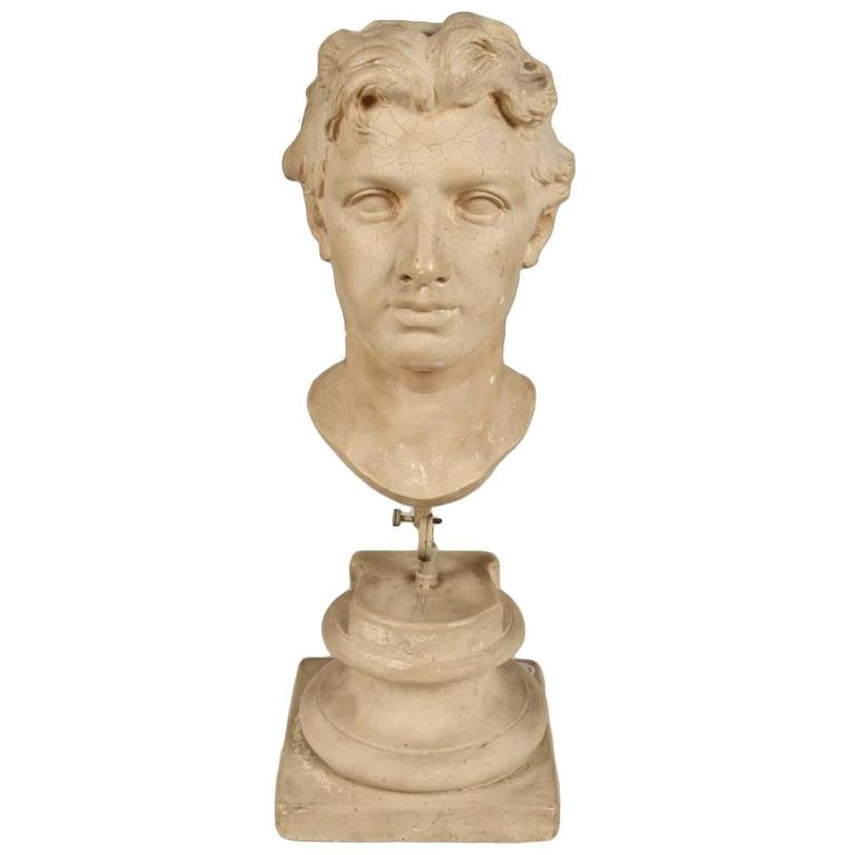 Plaster Bust of a Man on Stand For Sale