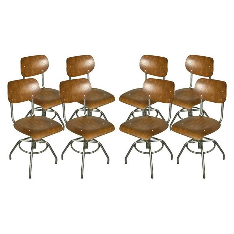 Eight French Industrial Steel And Wood Chairs, Adjustable Height For Sale