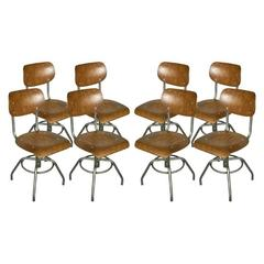 Eight French Industrial Steel and Wood Chairs, Adjustable Height