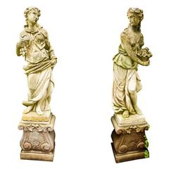"Pair of Hand-Carved Limestone Figures, ""Autumn"" and ""Spring"" on Pedestals"