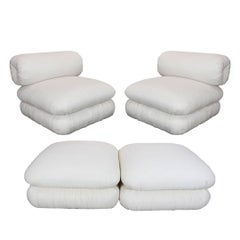 Pair of Unique and Sculptural Roll Back Slipper Chairs and Ottomans