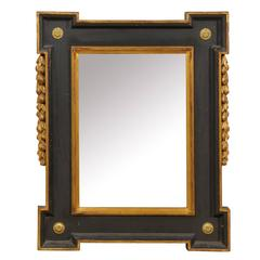 Black and Giltwood Flemish Style Mirror with Carved Floral and Foliage Motifs