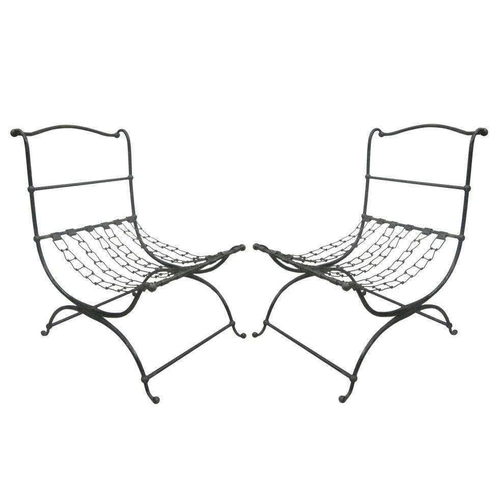 important pair of hammered iron and chain lounge chairs by jean