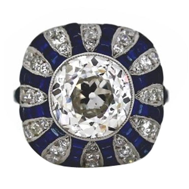 Art Deco Style 5.70 Carat GIA Cert Old European Cut Diamond Sapphire Ring For Sale