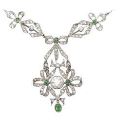1900s 0.15 Carat Peridot 2.53 Carat Diamond Platinum Pendant