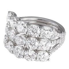 Triple row platinum diamond ring