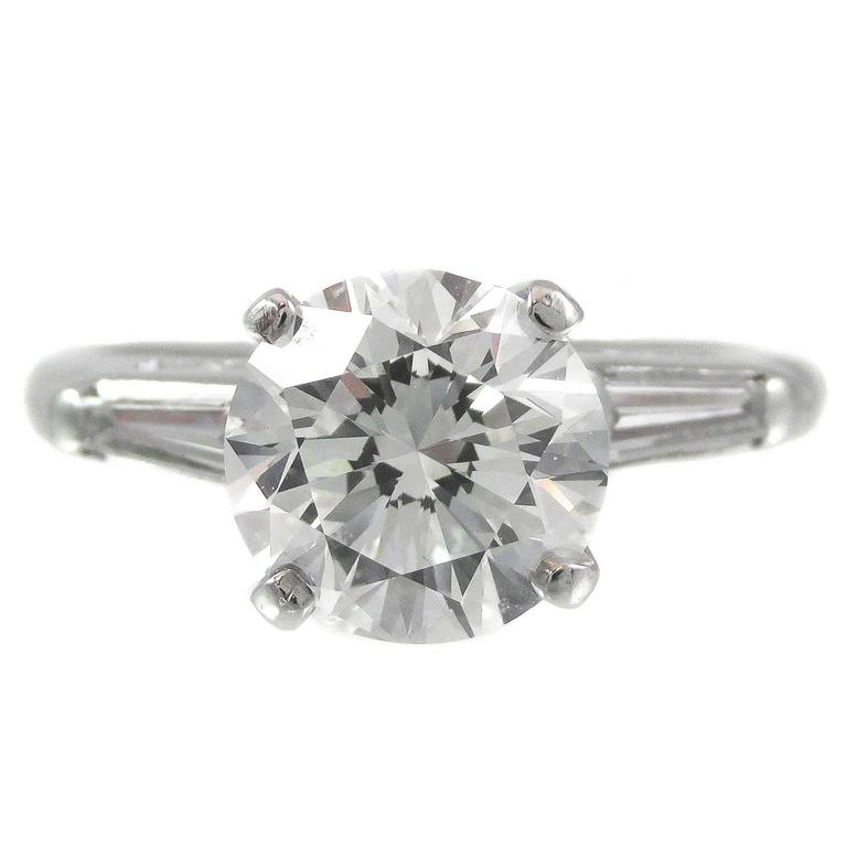 Two-Carat Round Brilliant and Tapered Baguette Diamond Platinum Ring For Sale