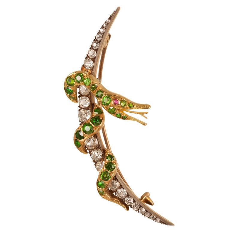A Demantoid Garnet & Diamond Serpent Brooch