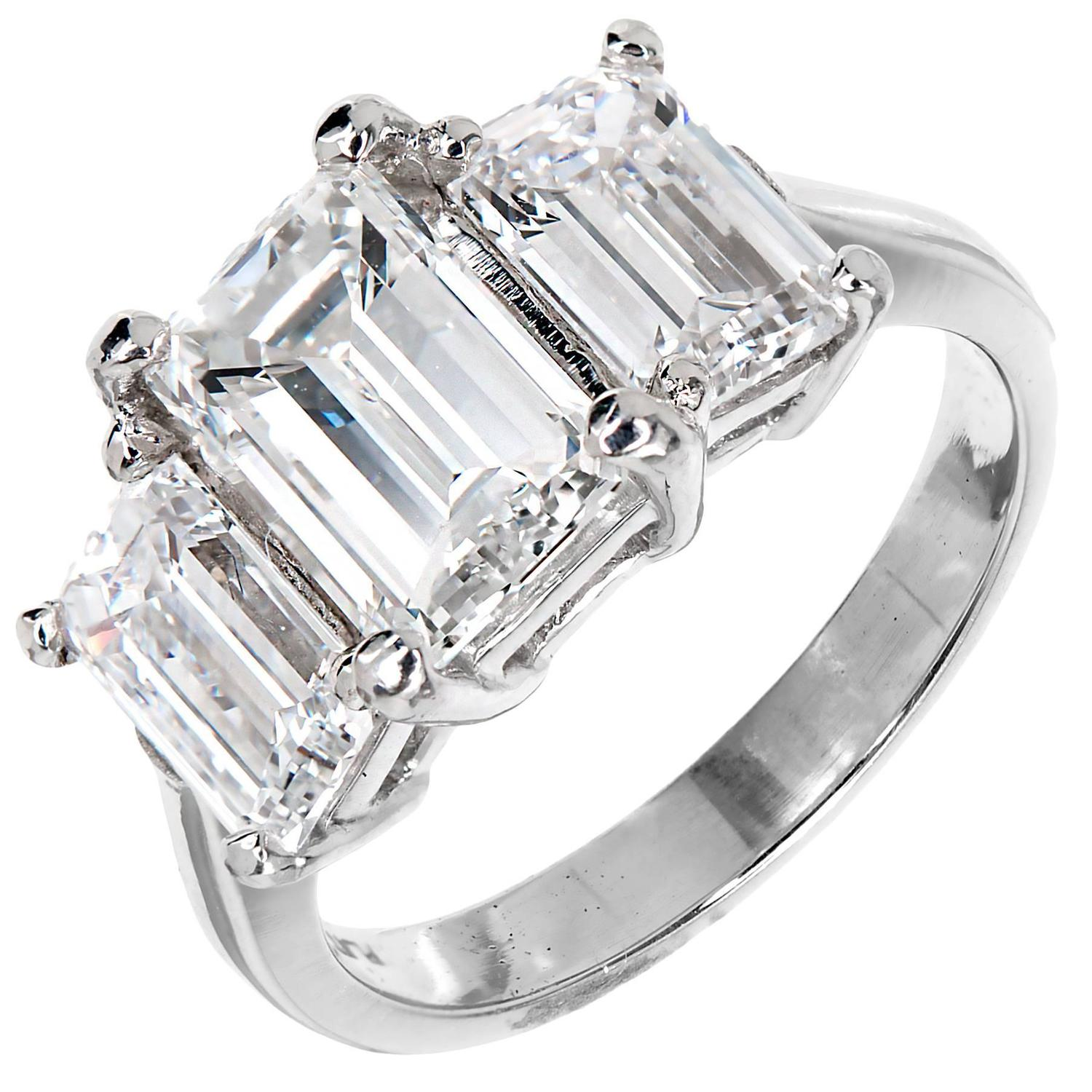 Peter Suchy Emerald Cut Diamond Three Stone Platinum Ring at 1stdibs