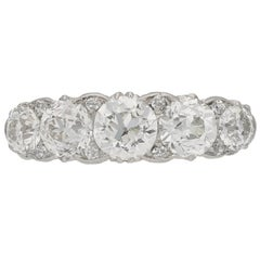Antique five stone diamond carved half hoop ring, circa 1905.