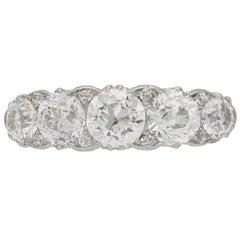 Antique five stone diamond carved half hoop ring, circa 1905.