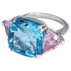 Candy colored aquamarine pink spinel platinum three stone ring