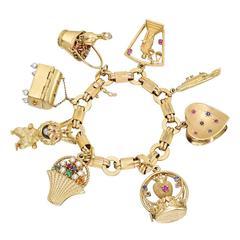 Gold and Gem-Set Charm Bracelet